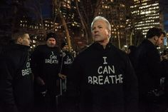 NYPD supporters wearing black hoodies with the words 'I can breathe' demonstrated outside City Hall Friday evening — a sick twist on Staten Island father of six Eric Garner's final words as he died from a police chokehold on July 17.