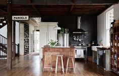 The Byron Bay Home of Anna and Andrew Swain and their family. Above – kitchen and living area. French armoire pantry and factory pigeon holes in hallway. Production – Lucy Feagins / The Design Files. Country Style Kitchen, Kitchen Inspirations, Luxury Kitchens, Gravity Home, Rustic Modern Kitchen, Home, Kitchen Design, Traditional Kitchen Inspiration, Home Decor