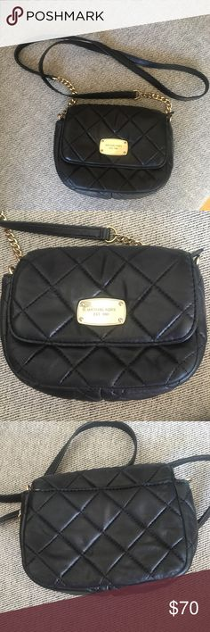 Michael Kors Crossbody Purse Black Michael Kors crossbody bag with gold colored accents. This is used, but in pretty good condition still. It currently has a few creases because it's been sitting in my closet, but these are not noticeable when the purse is full.   There is a pocket on the back side of the purse. There are 2 sections on the inside and a zippered pocket inside. Michael Kors Bags Crossbody Bags
