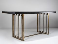 JEAN ROYÈRE, a table, 1954-55, France. Straw marquetery and brass. /