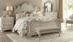 Sculptural acanthus leaf carvings enhance the regal design of this queen Estate Bed.