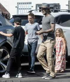 Harper Beckham dons maxi dress for outing with dad | Daily Mail Online