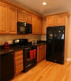 kitchen with oak cabinets with black appliances - Bing Images