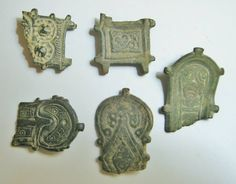 A Group of Visigothic Bronze Belt Plates and Fragments  CULTURE / REGION OF ORIGIN: Visigothic Spain.DATE: Circa 5th-6th Century AD