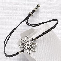 £18.00 'Days Of Our Lives' bracelet.   Oxidised sterling silver flower on waxed black cotton.