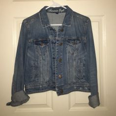 Brand New AE Jean Jacket Brand New American Eagle Jean Jacket! The sleeves can be rolled of unrolled (see pictures). Hits about mid torso to right above waist (definitely depends on height). Moves with you, so it is very comfortable and durable. Perfect for going over dresses! Size Large. American Eagle Outfitters Tops