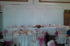 White Chair Covers with Pink Sash