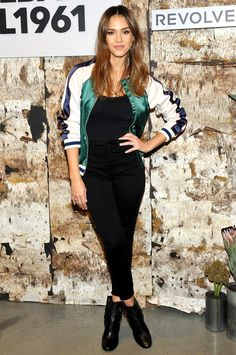 Jessica Alba in a black top, DL1961 jeans, a bomber jacket and booties