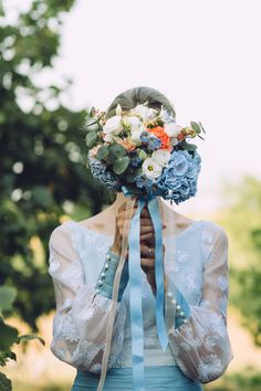 dusty blue and orange bouquet - love the blue vintage wedding dress!