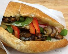 Vegetarian Philly Cheese Sandwich: Mushroom, onion, red and green bell pepper, provolone cheese.