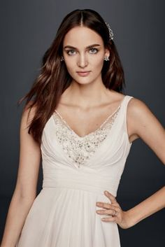 "The beautifully embellished sweetheart bodice of this A-line extra length wedding dress is balanced by a chiffon A-line skirt that's easy to wear and moves effortlessly.  David's Bridal Collection  4"" Extra Length"