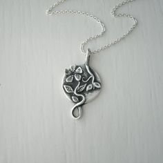 Silver Periwinkle Flower Necklace Pendant / by ElizabethSMurray