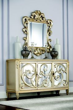 Fit for a queen, this light gold buffet from the Jessica McClintock features ornate details and a stone top for serving.