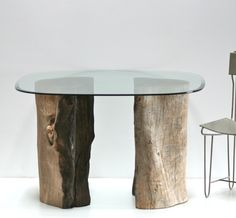Dining table organic tree stump trunk table bases. Rescued before the chipper could get to them. We acquired this tree section after a wild fire burned through Alto, NM. The center still exhibits the scar from partial burning. Each is 22 inches in diameter. Shown with glass top 48 inches in diameter. Kiln dried, leveled, sealed, no VOC finish. Obviously, the pedestals will handle a larger piece of glass for dining, console, sofa table, etc.