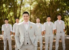 Groomsmen in grey suits with the choice of a lavender or light pink bow tie. No jackets either:)