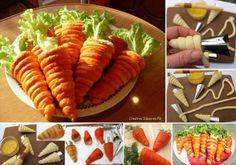 """Hoorntjes van bladerdeeg, na het bakken """"verven"""" met wortel/tomaten sap en vullen met een frisse salade van b.v kipfilet, komkommer, geraspte wortel, yogho-mayo en kruiden. en een blaadje ijsbergsla als wortelgroen."""
