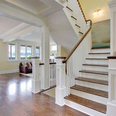traditional staircase by RW Anderson Homes, wood stair railing with white support beams