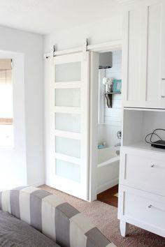 Beautiful white sliding barn door via House of Smiths. Custom white Barn Door Hardware from Basin Custom.  http://www.basincustom.com