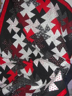 Mike and Marsha's Wedding quilt, red, white and black twister quilt!