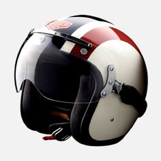 This limited edition motorcycle helmet from TAG Heuer, is inspired by Steve McQueen and his role in the film Le Mans, in which he wore a Heuer Monaco watch. The retro-styled fiberglass helmet, which features a racing stripe matching the colors on McQueen's driving gear, vintage Heuer logo, steel hardware and leather trim