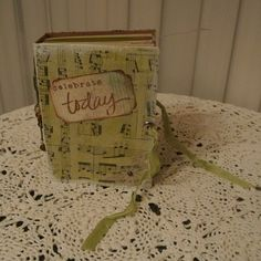 Altered Book. Former cereal box and now an altered book to add photos and mementos.  The music collage comes from tissue paper. by CreatingEnchantedMem on Etsy https://www.etsy.com/listing/206940971/altered-book-former-cereal-box-and-now