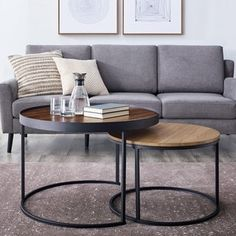 Give a nod to industrial and modern styles in your family room with this Carbon Loft two-tone nesting coffee table set. Featuring powder-coated steel frames for sturdiness and stability, this set can be spread throughout your living room to provide an extra surface for guests or compacted to save space. Features: high-grade MDF, laminate and powder coated steel construction large table features tray-top rim ideal for small space living versatile use as one large coffee table or two small…