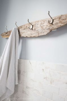 Driftwood beachy towel rack. A beautiful piece of driftwood found on the beach is upcycled with useful hooks for towels. Great rustic bathroom decor. http://SustainMyCraftHabit.com                                                                                                                                                                                 More