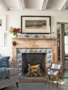 Gorgeous Decorative Tile Ideas This fireplace surround displays a band of antique Delft tiles—classic accent tiles that bring timeless charm Fancy Living Rooms, Fireplace Design, Fireplace Tile, Vintage Fireplace, Home, Wooden Fireplace, Mediterranean Home Decor, Fireplace Surrounds, Tuscan Style