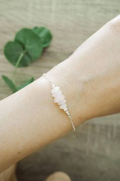 My rose quartz gemstone bar bracelet is a lovely, dainty design that can come in either sterling silver or 14k gold fill. This dainty gemstone bar bracelet features a row of round or chip rose quartz beads alongside two metal beads. The rose quartz bar is about an inch long, and can