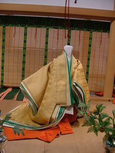 Noble ladies in the Heian era wore gorgeous silk robes. The color combinations, graduations and patterns were important and often referred to the seasons. These are some typical combinations.  Citrus colour - early summer wear    Colour combinations of Garments - Tale of Genji - A Courtier's Life by crimsongriffin28, via Flickr