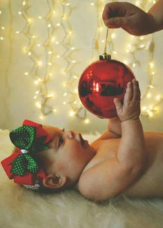 Christmas Baby Photos - edit out the hand, magical! Christmas Baby, Babies First Christmas, Baby Christmas Pictures, Baby Christmas Photoshoot, Christmas Ornament, Christmas Ideas, Xmas Photos, Holiday Pictures, Xmas Pics