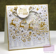 Here's another card I made using the New Crafter's Companion Die'sire Christmas Create-A-Card Die - Over the Rooftops.  I sponged on Golden Glitz Delicata Ink by using the die as a stencil. This time I sponged the ink much heavier so there was a lot of gold on the designs. Then I embossed with clear embossing powder. The gold looks so good on the Shimmering Pearl White cardtstock.  I made this into a shaker card - filled with faux snow and silver & gold star confetti. It's really fun because…