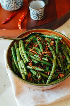 Sichuan Dry Fried Green Beans - popular both in China and the US. Restaurants deep-fry them but we made them healthy by searing them in a dry wok without oil. Vegetable Recipes, Vegetarian Recipes, Cooking Recipes, Healthy Recipes, Veggie Dishes, Side Dishes, Cooking Wine, Asian Cooking, Gourmet