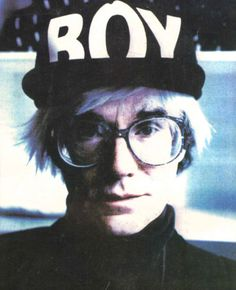 Andy Warhol is seen posing in an iconic BOY London Cap.