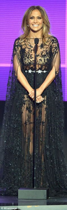 Star power: The singer wore a flowing, sheer black gown covered in a star pattern for her ...