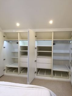 Gloss white wardrobe with shoe trays, drawers, hanging rail, pull-out tie racks, lights and shelves.
