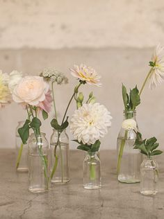 Like the different size bottles w/ varying numbers of flowers as opposed to standard large centerpieces.
