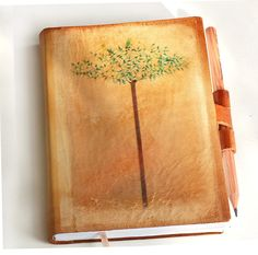 Free initials Spring Tree with two birds leather journal. $39.00, via Etsy.