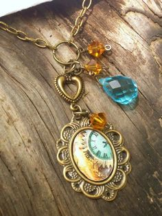 altered art pendant necklace with aqua and amber crystal and clock image.  $21.95