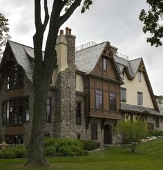 Tudor home exterior. Love the stone on the chimney giving way to stucco.