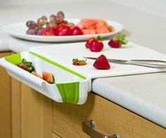 cutting board with scrape-off tray