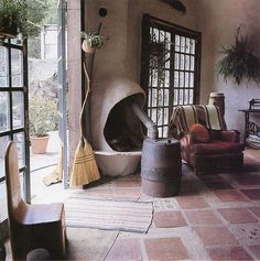 by Old Chum, via Flickr...love the mismatched floor tiles. Clay for thermal mass.