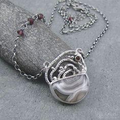 Handmade silver necklace with amazing agate and garnet. Natural and raw. --- #amadestudio #agate #pendant #necklace #garnet #handmadejewelry #handcraftedjewelry #jewellery #silvercraft #silverart #iloverhandmade #hammered #raw #artisanjewelry #natureart #jewelrymaker #jewelrydesigner