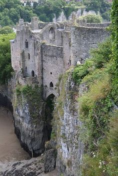 Chepstow Castle ruins in Monmouthshire, Wales, on top of cliffs overlooking the River Wye, is the oldest surviving post-Roman stone fortification in Britain. Its construction was begun under the instruction of the Norman Lord William Fttzosbern, soon made Earl of Hereford, from 1067, and it was the southernmost of a chain of castles built along the English-Welsh border in the Welsh Marches.