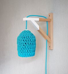 Hey, I found this really awesome Etsy listing at http://www.etsy.com/listing/163551934/dipped-wood-wall-lamp-with-crocheted