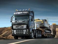 Volvo FH 16 700-750 with a heavy equipment transport http://www.shipyourcarnow.com
