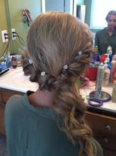 simple but elegant twist and pull to the side with curls for prom.