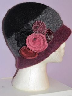 Tri-coloured cloche with leather flowers
