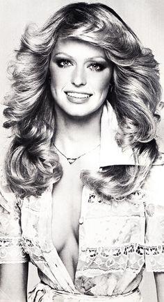 Farrah Fawcett my favorite hair style, my hair needs to grow faster!!!