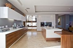 The Chestnuts, White, timber, black and concrete kitchen: